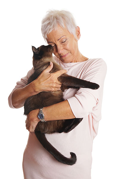 elderly woman holding cat